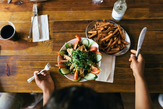 Aerial View Of Salad And Fries