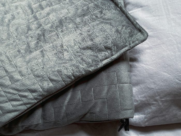 how to wash a weighted blanket Still Life Of Gray Weighted Blanket In Bedroom