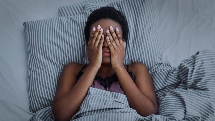 circadian rhythm disorder | African American Girl Closed Eyes With Hands In Bed