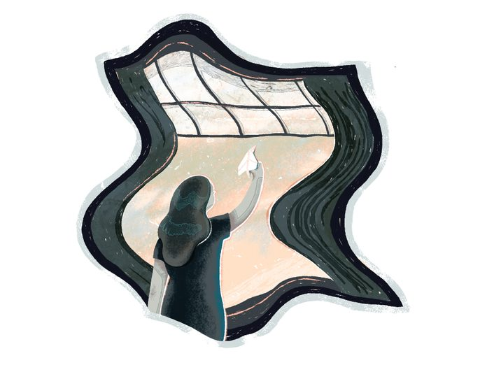 covid one year later   illustration of a woman looking out a window and ready to throw a paper plane outside