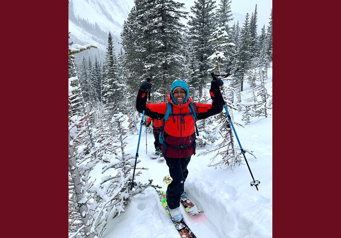 being outdoors   image of author Deja Leonard in the snow with skis