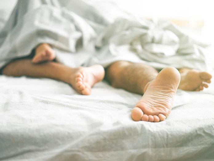 sex at midlife | sex in 40s | sex in 50s | sex in 60s | Close,up,of,male,and,female,feet,on,a,bed