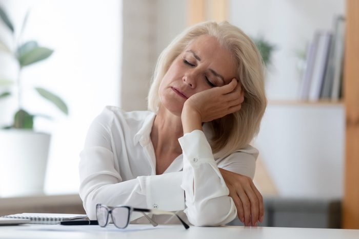 perimenopause symptoms | Exhausted,aged,woman,worker,sit,at,office,desk,fall,asleep