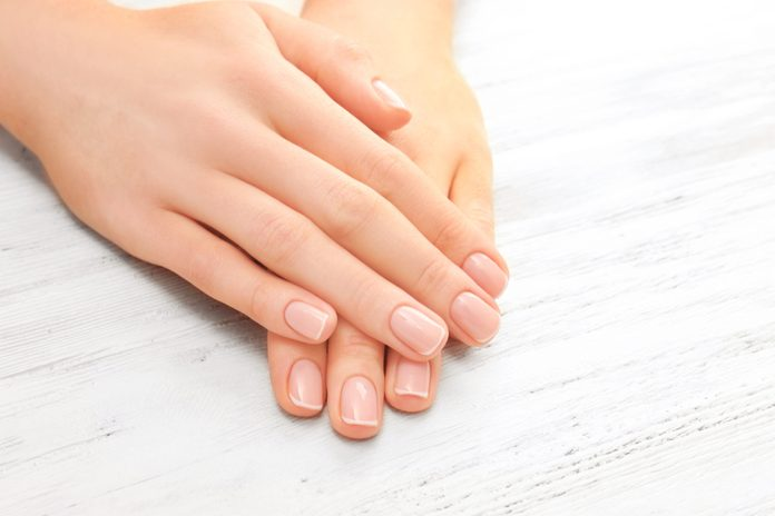 healthy nails | woman with her hands and healthy nails on a white table