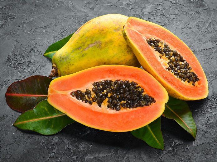 Fresh papaya on a stone ground.