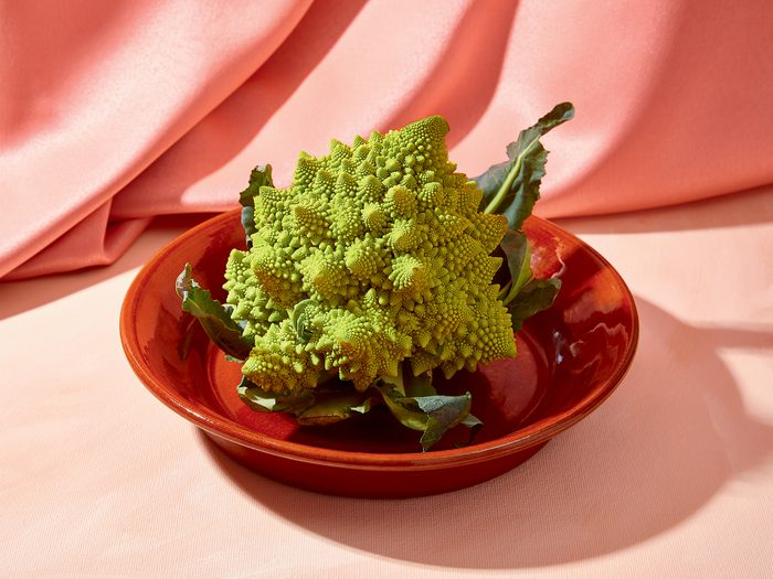 health benefits of romanesco   romanesco on plate in front of pink fabric
