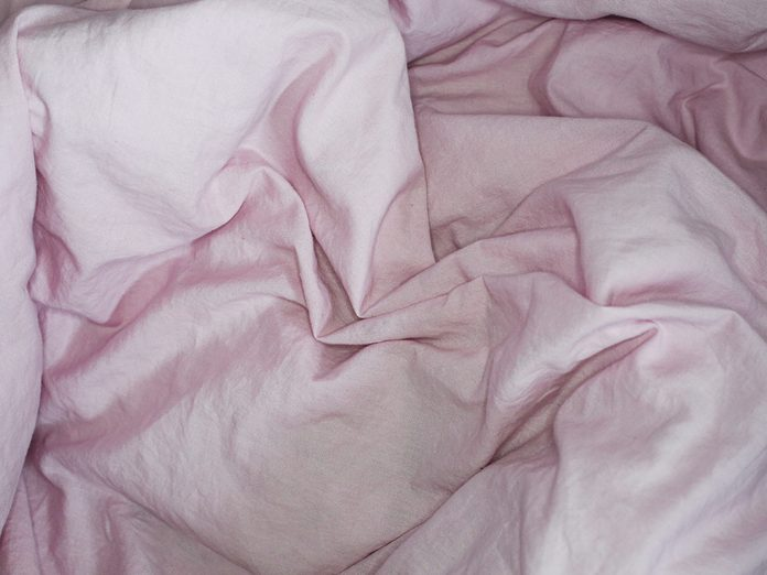good sex   Top,view,with,crumpled,pink,bed,sheet.,cotton,textile,waved.