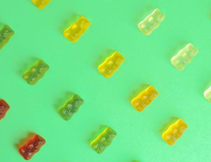 biotin supplements | Gummy,bear.,kids,vitamins,on,colorful,background.