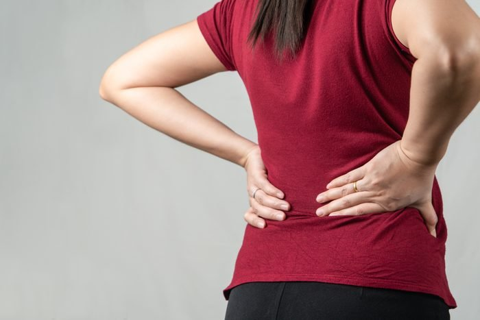 back pain   woman with back pain