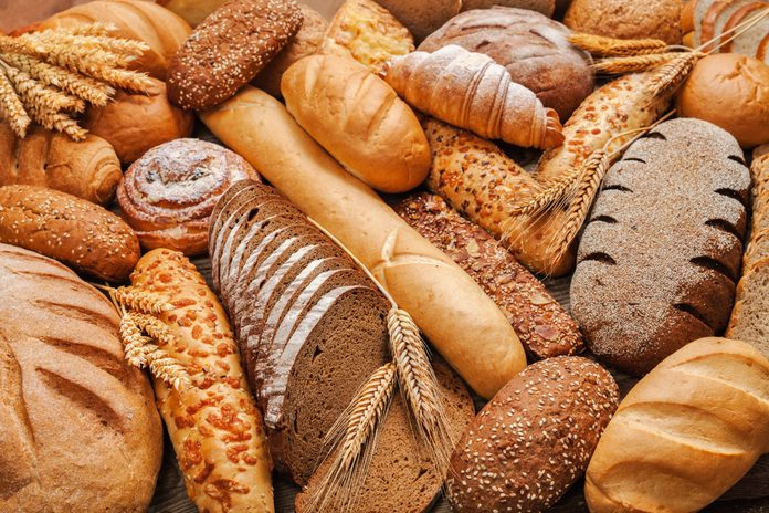healthy bread | a stack of different breads on a table