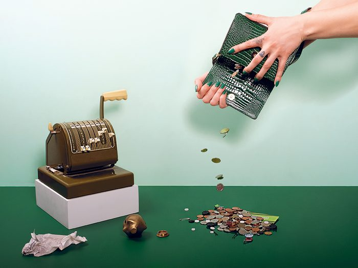 covid economic recovery for women | hand pouring coins out of a purse