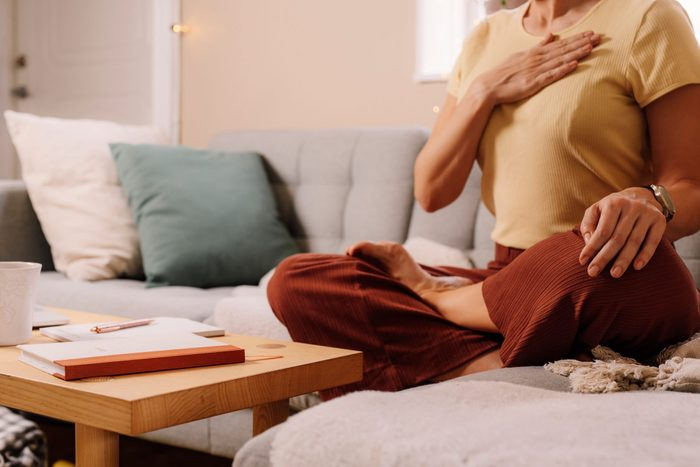daily meditation   Woman Indoors Relaxing Meditating And Doing Breathing Exercises