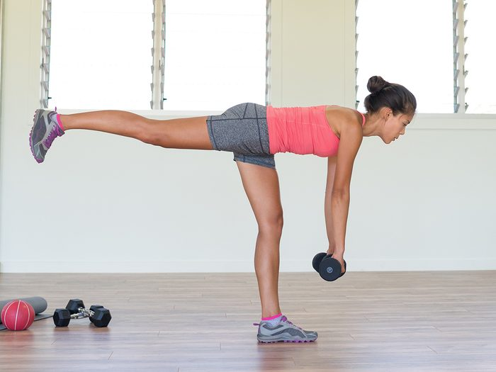 Woman,strength,training,at,gym,exercising,hamstring,and,lower,back