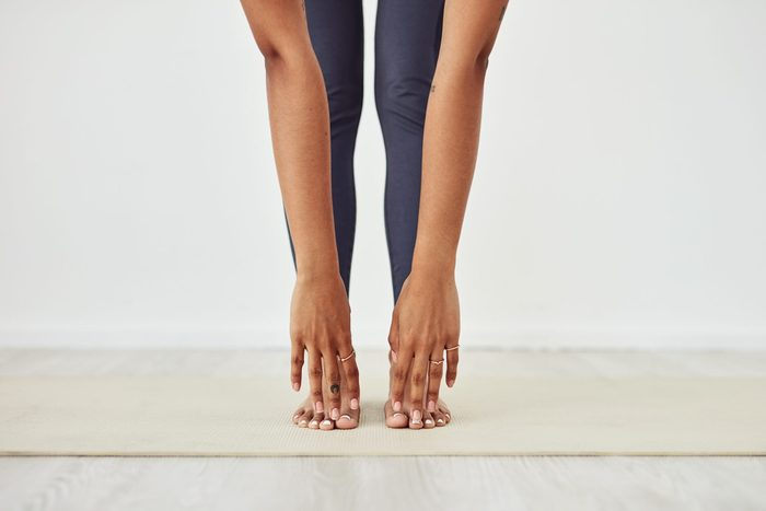 types of stretching | closeup of woman touching her toes