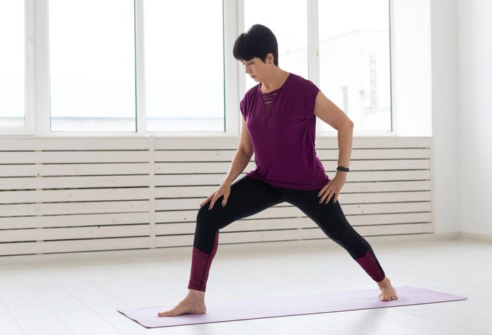 calf stretches   Yoga,,people,concept, ,a,middle Aged,woman,doing,a,yoga
