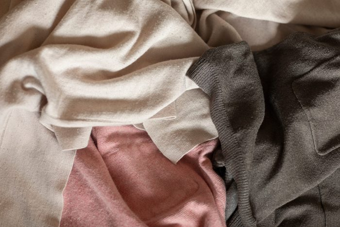 what is lyocell | Old,clothes,in,pink,and,grey,colors,laying,on,a