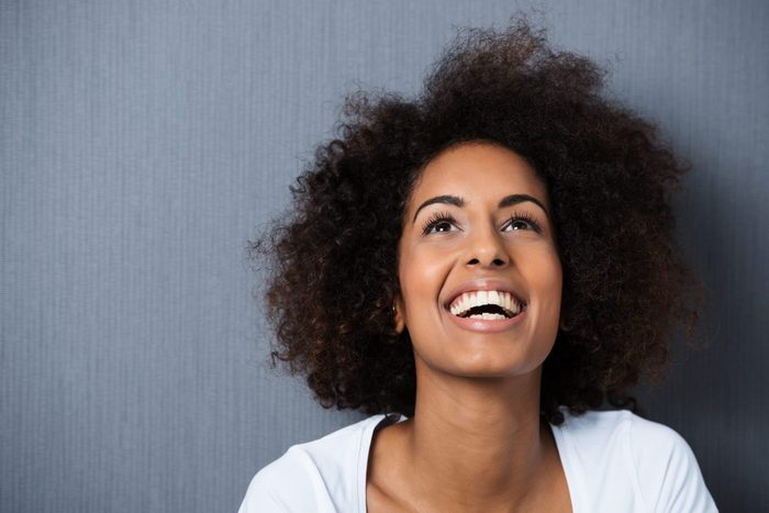 ambivert   Laughing,african,american,woman,with,an,afro,hairstyle,and,good