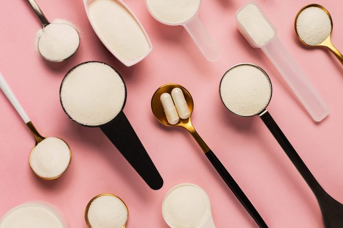 collagen powder | flat lay image of collagen supplements in spoons on a pink background
