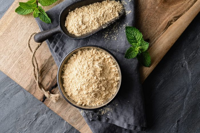 maca root   Dietary Supplement Maca Root Powder In A Bowl And Scoop With Copy Space