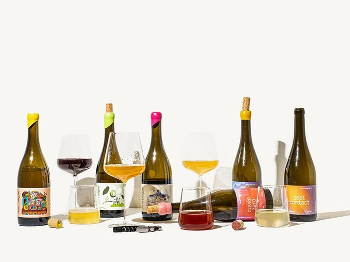 Acid League Wine Proxies | bottles of wine proxies with glasses next to them