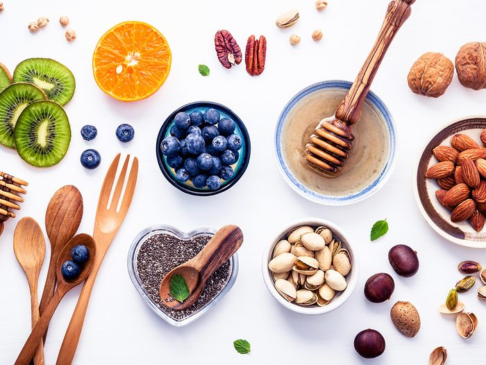 plant-based snacks   Ingredients,for,a,healthy,foods,background,,nuts,,honey,,berries,,fruits,