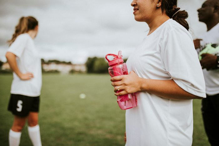Female,football,player,holding,a,water,bottle