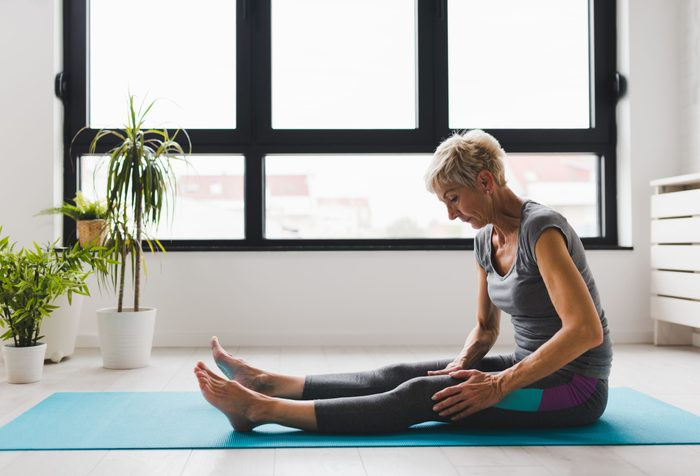 Active,senior,woman,practicing,yoga,indoors.,exercise,for,older,adults