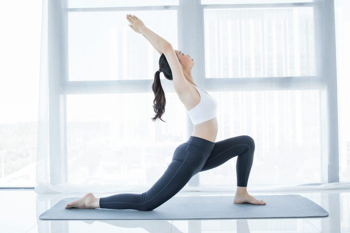 Yoga,on,rooftop.,young,woman,stretching,on,roof,with,city