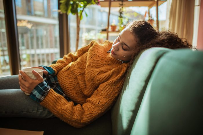can allergies make you tire | Woman Is Resting On The Sofa In Her Apartment