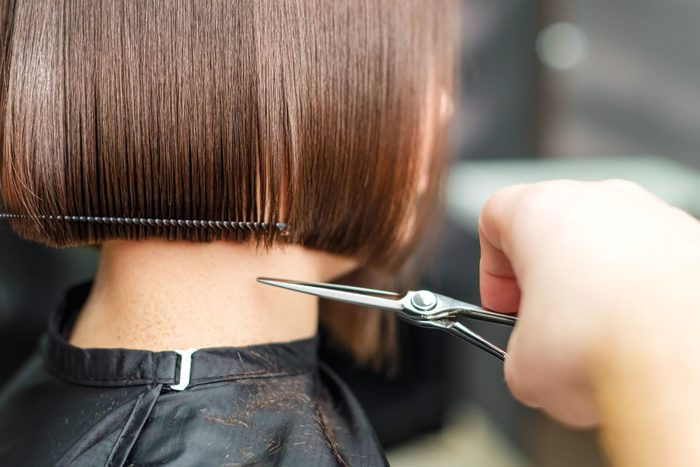 How much to tip your hairdresser- Hairdressers Hands Are Cutting Brown Short Hair