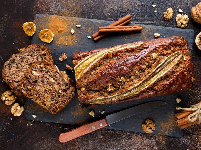 Homemade,banana,bread,with,walnut,and,cinnamon,on,a,stone
