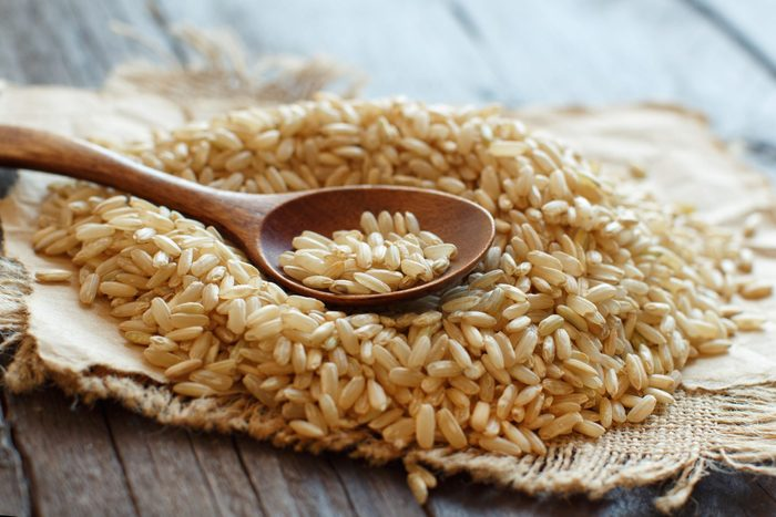 Pile Of Brown Rice With A Wooden Spoon-brown-rice-arsenic