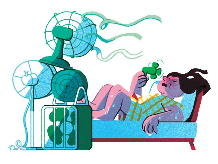 why do we sweat   illustration of a woman in bed sweating with the fan on high