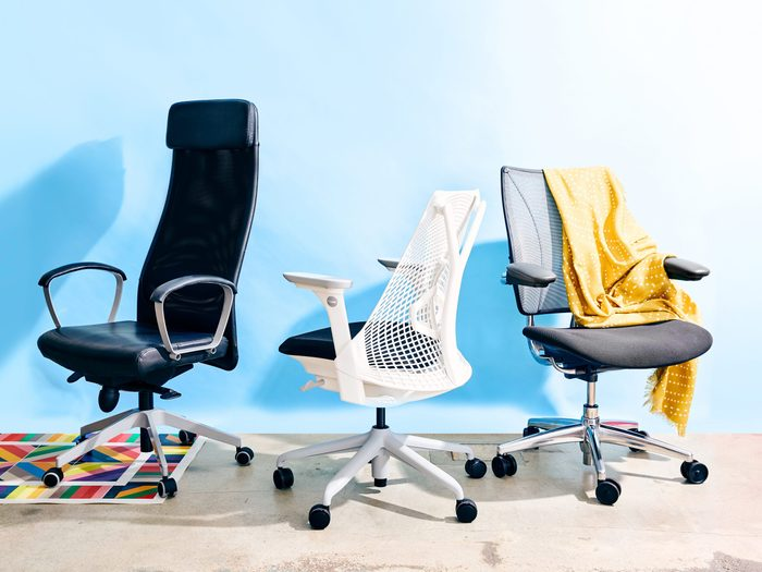 best ergonomic chairs | image of three chairs against a blue backdrop